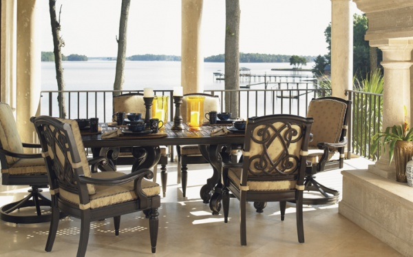 luxury patio including luxurious outdoor dining set with six wood and tan chairs