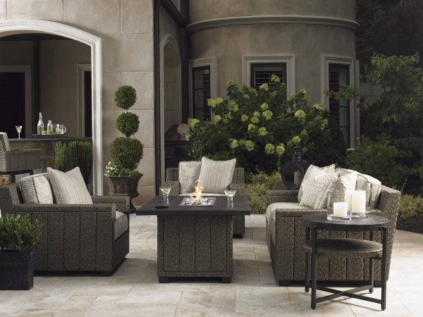 luxury patio including brown sofa, chairs, and square top table with round top end table