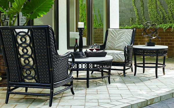 luxury patio including black and green colors with round black and white table and two black and green chairs