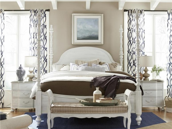 luxury home furniture master bedroom with white canopy bed and white and brown bedding with white nightstands