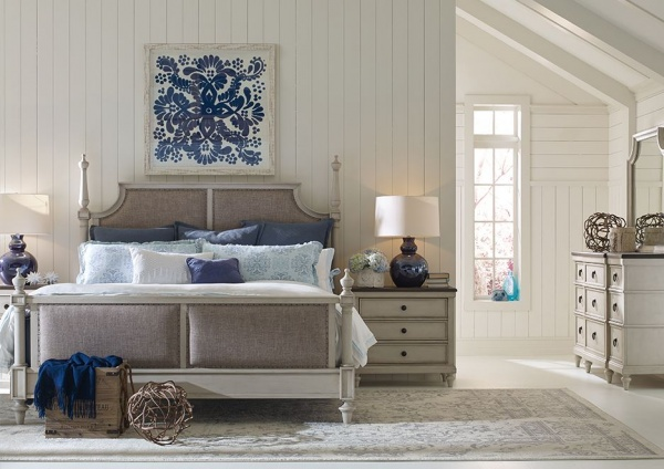 luxury home furniture master bedroom with grey, white, and blue colors with grey bed frame and furniture with blue accents