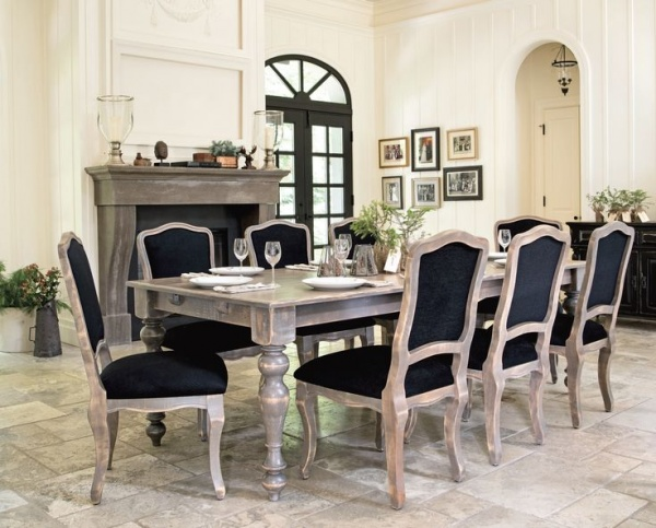 luxury dining room with large wooden table and eight black and wood chairs