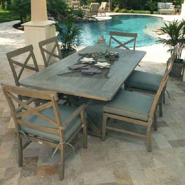 luxury patio including rectangular wooded dining table with six chairs next to a swimming pool