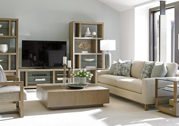 luxury living room featuring off white and light brown colors with cream sofa with pillows, light brown furniture and white floors