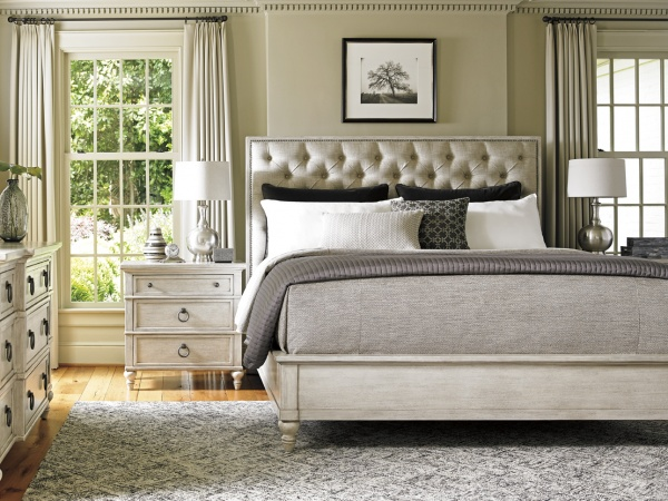 luxury home furniture master bedroom with grey bed, and white wooden nightstands and dresser