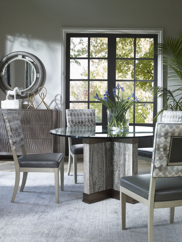 luxury dining room with round glass top table with four grey chairs