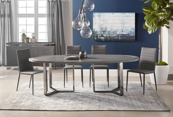 luxury dining room with round grey table and four grey chairs with a grey rug