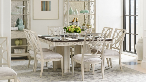 luxury dining room with seating for six featuring a white wooden table and six white chairs