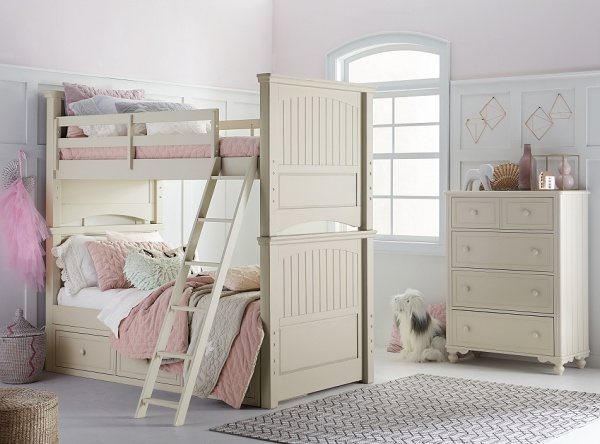 luxury finished interior bedroom with cream colored bunk beds with cream furniture and white and pink bedding