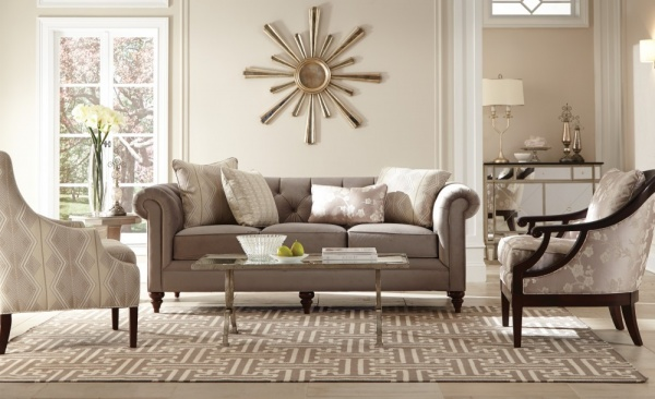 luxury living room featuring grey color scheme, grey sofa with grey chairs and grey area rug