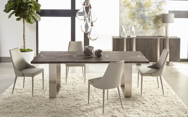 luxury dining room with brown wooden table with four cream colored chairs and cream shag rug