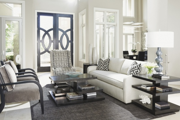 luxury living room featuring white and grey color scheme with white sofa, grey chairs and black furniture