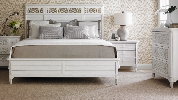 luxury home furniture master bedroom with white bed, white bedding, and white furniture