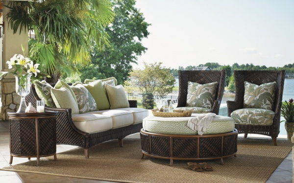luxury patio including with brown, white and olive color scheme including sofa, two chairs and round table