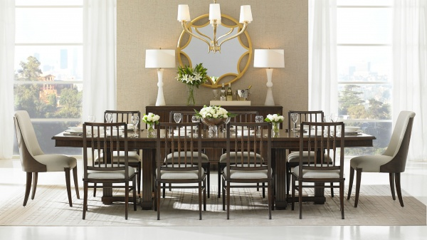 luxury dining room with wood dining room table and ten wood chairs with cream seats and backs