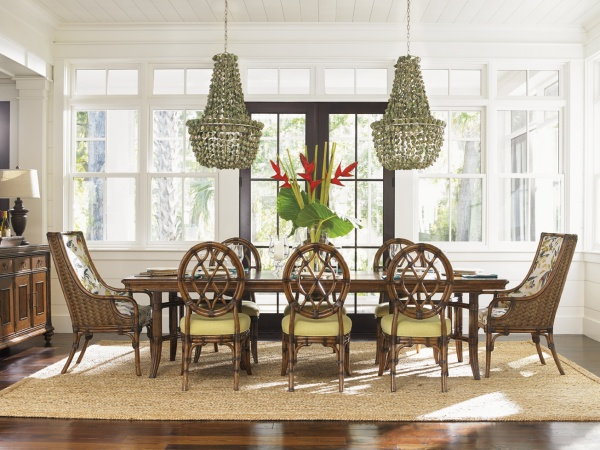 luxury dining room with brown wood dining room table with eight brown wicker chairs
