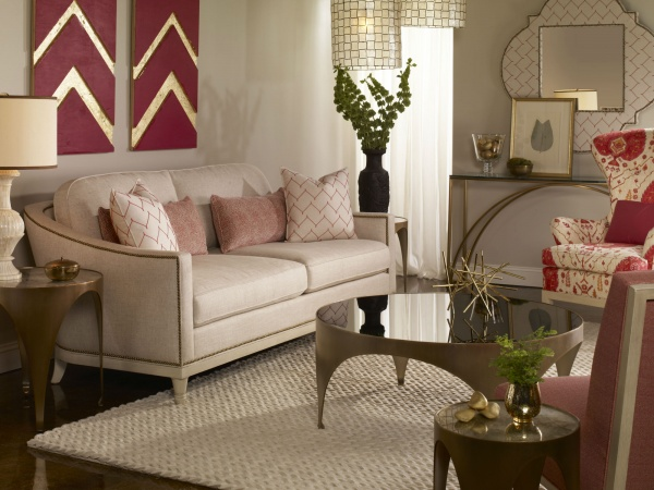 luxury living room featuring off white and red colors with off white sofa with pink pillows and red and white chairs with round table