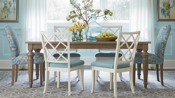 luxury dining room with cyan, white and brown color scheme with brown table, and white and cyan chairs