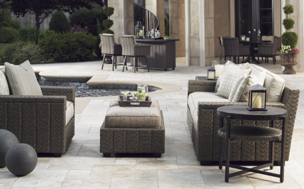 luxury patio including brown outdoor furniture including sofa, chair and small table