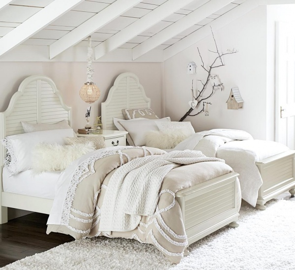 luxury finished interior bedroom with white and cream color scheme with two white wood beds and white shag rug and white nightstand