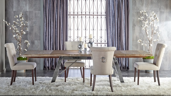luxury dining room with large wood dining room table and four chairs with white shag run and purple accents
