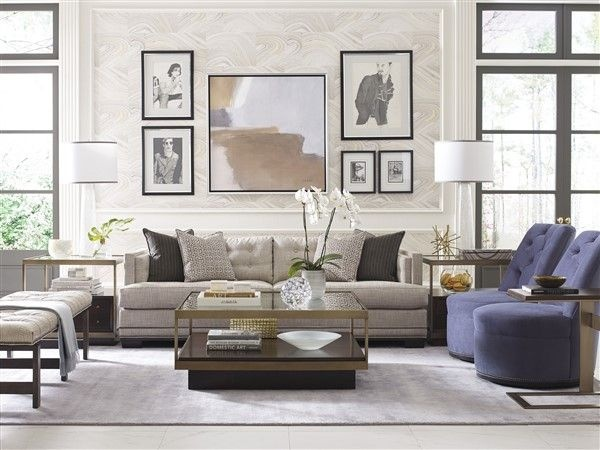 luxury living room featuring grey sofa with light blue chairs and glass top table