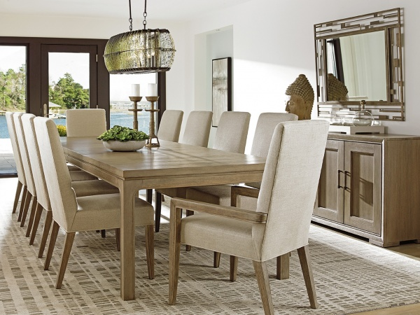 luxury dining room with light brown table featuring ten eggshell and wood chairs