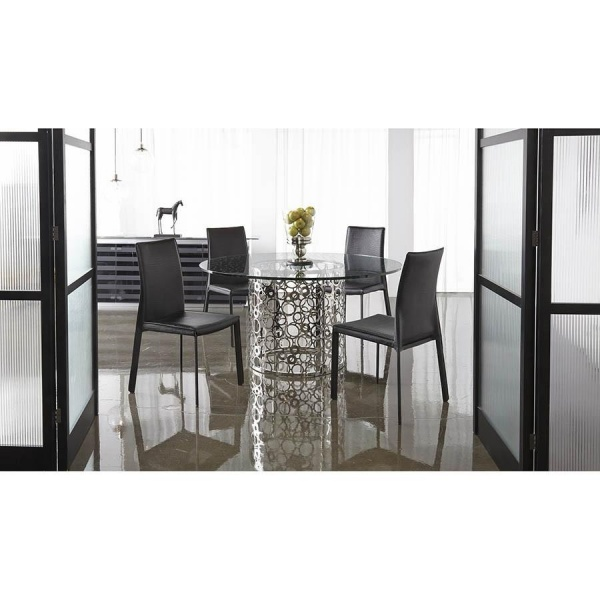 luxury dining room with modern round metal table with glass top and four black chairs