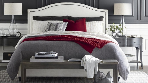 luxury home furniture master suite with grey white and red color scheme, featuring bed, wood nightstands and end table