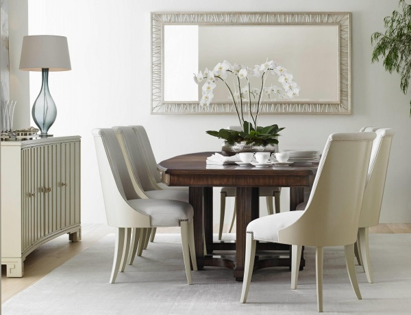 luxury dining room with wooden dining room table with eight white chairs and white cabinets