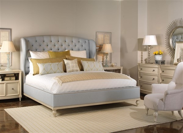 luxury home furniture master bedroom with light blue, gold and white color plan, with cream dresser and night stands