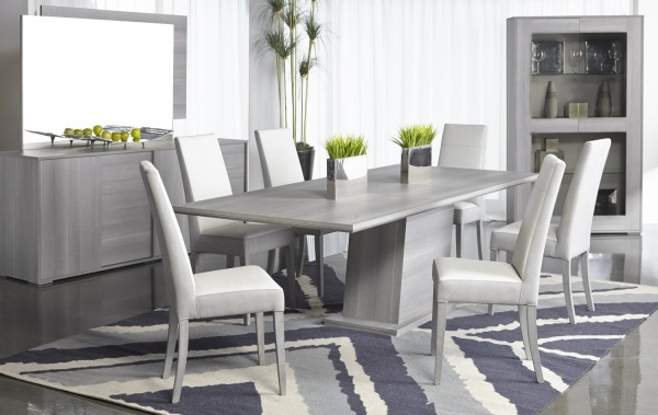 luxury dining room with grey wood table with grey leather chairs with grey furniture and accents