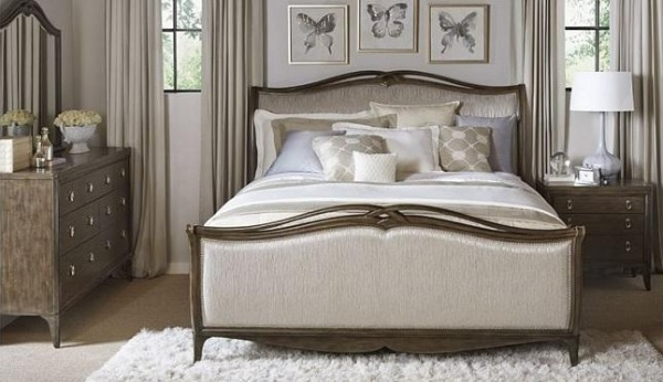 luxury home furniture bedroom with white, cream, and light brown color scheme with cream and brown wood bed with light brown dresser and nightstand