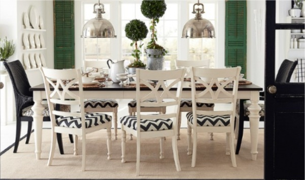 luxury dining room with black and white table and black and white chairs with zigzag pattern